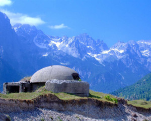 An old communist bunker overlooking the spectacular peaks of Valbona Valley. An estimated 700.000 concrete bunkers were built by Hoxha's regime.
